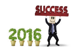 Man lifting a success text with numbers 2016 Royalty Free Stock Images