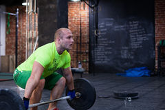 Man is lifting up the barbell Stock Photo