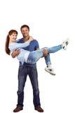 Man lifting up his girlfriend Stock Photos