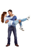 Man lifting up his girlfriend Stock Images