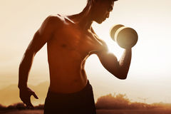 Man lifting weight. On outdoor Stock Image
