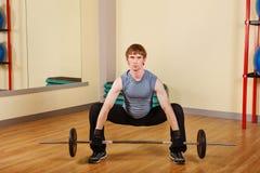 Man lifting a weight Royalty Free Stock Photos