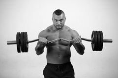 Man lifting weights. A bodybuilder training with a dumbbell Stock Photos