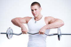 Man lifting weights. Powerful muscular man lifting weights Royalty Free Stock Photo