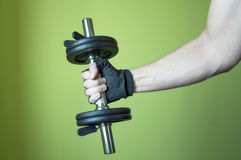Man lifting weights Stock Images