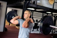 Man is lifting weights royalty free stock photo