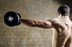 Man lifting weights with shoulders training Royalty Free Stock Image