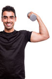 Man lifting weights. Smiling man lifting weights over white background Royalty Free Stock Photo