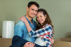 Man lifting woman in his arms Royalty Free Stock Photo