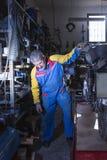 Man lifting a work platform Royalty Free Stock Images