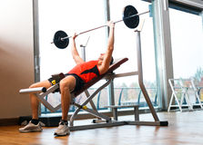 Man lifting a yoke Stock Photo