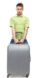 Man lifts silver luggage Stock Photos