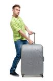 Man lifts silver trunk Stock Image