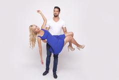 Man lifts woman. Man lifting cute blonde women or she may be falling. In horizontal with lot of copy space Stock Images