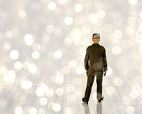 Man in light. With motes Royalty Free Stock Photos