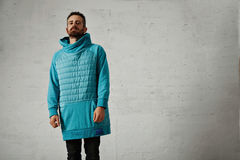 Man in a light blue padded hoodie Royalty Free Stock Photo