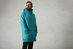 Man in a light blue padded hoodie Royalty Free Stock Images