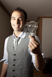 Man with a light bulb Royalty Free Stock Photography
