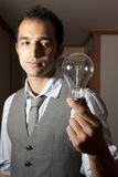 Man with a light bulb Stock Photos