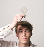 Man with light bulb Stock Photography