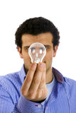 Man with light bulb on hand Stock Images