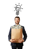 Man with light bulb and money Royalty Free Stock Images