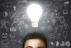 Man with a light bulb. Over his head Royalty Free Stock Photo