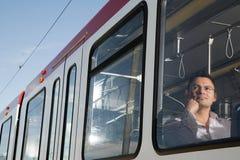 Man on light rail Stock Images