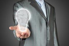 Man with lightbulb Stock Photos