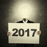Man with lightbulb and number 2017 Royalty Free Stock Photos