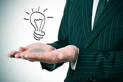 Man and lightbulb Stock Photography