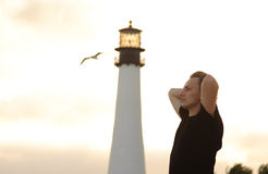 Man and lighthouse Royalty Free Stock Photography
