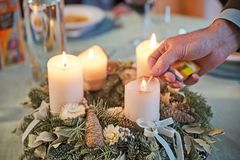 Man lighting the candles on Advent wreath Royalty Free Stock Photos