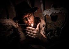 Man Lighting Cigarette Stock Image