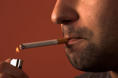 Man lighting a cigarette Stock Photography