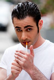 Man lighting cigarette Stock Photo