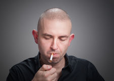 Man lighting a cigarette Royalty Free Stock Image