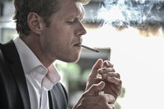 Man lighting cigarette Royalty Free Stock Images
