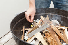 Man is lighting the fire for bbq Stock Image