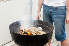 Man is lighting the fire for bbq Royalty Free Stock Images