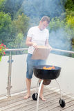 Man is lighting the fire for bbq Royalty Free Stock Image