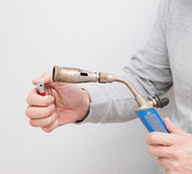 Man lighting a gas burner Stock Image