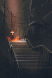 Man with lights umbrella standing on stair in the night rain Stock Photo