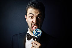 Man liking a lollipop Stock Image