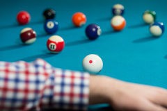 Man Lining To Hit Ball On Pool Table Stock Image