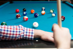 Man Lining To Hit Ball On Pool Table Royalty Free Stock Photo