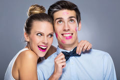 Man with lipstick marks and smiling woman Royalty Free Stock Images