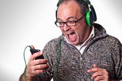 Man listen music on headphones and scream aloud stock images