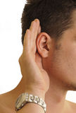 Man listening. Hand on his ear, isolated Stock Photo