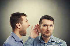 Man listening angry screaming man Royalty Free Stock Images